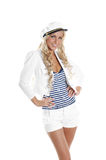 Image of a young blond posing in a sailor costume Stock Images