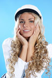 Image of a young blond posing in a sailor hat Royalty Free Stock Photo