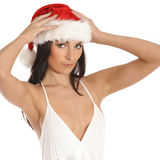 Image of a young brunette girl in a Christmas hat Royalty Free Stock Photo