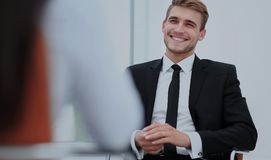 Image of young businessman communicating with his colleague. Handsome smiling businessman talking. intewiev at office Stock Images