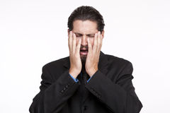 Image of a young businessman crying Royalty Free Stock Images