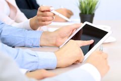 Image of young businesspeople using touchpad at meeting Royalty Free Stock Photography