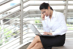 Image of  young businesswoman has problems while using laptop Stock Photos