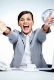 Success. Image of young businesswoman shouting in gladness with raised arms royalty free stock image