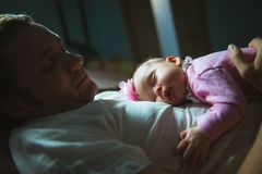 Image of young dad with cute little daughter in Stock Image