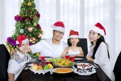 Young family having Christmas dinner at home Stock Photo