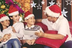 Young family with tablet at Christmas time Stock Images