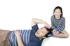 Young father looks surprised with hair rollers Royalty Free Stock Image