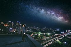 Female manager looking at stars on the rooftop Royalty Free Stock Photos