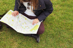 Image of young female tourist with map looking for a way Royalty Free Stock Photos