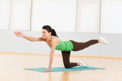 The image young girl does exercises. Stock Image