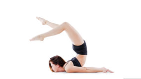 Image of young girl doing acrobatic stunt. On white Stock Photos