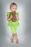 Young girl eating bar of chocolate Stock Images