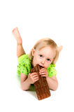 Young girl eating bar of chocolate Royalty Free Stock Image
