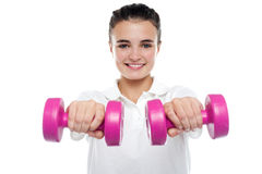 Image of young girl posing with dumbbells Royalty Free Stock Photo