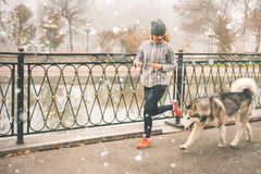 Image of young girl running with her dog, alaskan malamute Stock Photography
