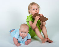 Young girls eating bar of chocolate Royalty Free Stock Images