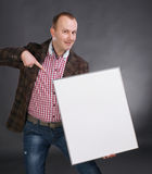 Image of a young handsome man. With a blank banner stock photo