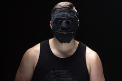 Image of the young man in handmade mask Royalty Free Stock Photography