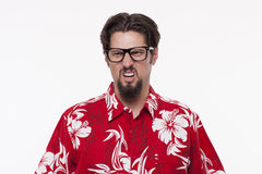 Image of a young man in Hawaiian shirt making a face Royalty Free Stock Photography