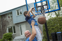 Image of young man and his son playing basketball. An Image of young men and his son playing basketball Royalty Free Stock Photo