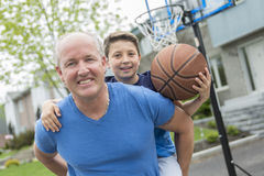 Image of young man and his son playing basketball. An Image of young men and his son playing basketball Stock Photo