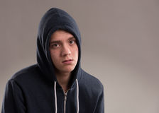 Image of young man in hooded sweater Royalty Free Stock Photos
