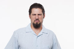 Image of a young man making a face while standing against white Royalty Free Stock Photography