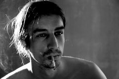 Image of young man smoking. Stock Photography