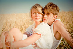 Image of young man and woman on wheat field Royalty Free Stock Images