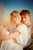 Image of young man and woman on wheat field Stock Photography