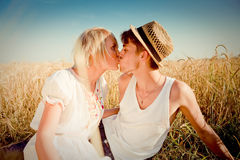 Image of young man and woman on wheat field Stock Image