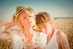 Image of young man and woman on wheat field Stock Photo
