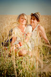 Image of young man and woman on wheat field Royalty Free Stock Image