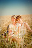 Image of young man and woman on wheat field Stock Images
