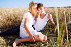 Image of young man and woman on wheat field Royalty Free Stock Photo