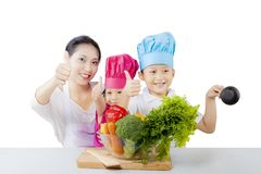 Young mother and her children showing thumbs up Royalty Free Stock Photography