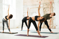 Image of young people doing yoga in gym Royalty Free Stock Photos