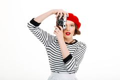 Young photographer woman. Image of young photographer woman isolated over white background wall holding camera Stock Photo