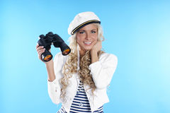 Image of a young sailor girl holding binoculars Royalty Free Stock Image