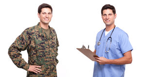 Image of a young soldier and male nurse posing against white. Soldier and male nurse posing against white Stock Image