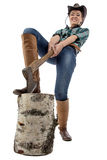 Image of young woman chops wood Royalty Free Stock Image