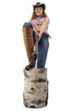 Image of young woman chops wood Royalty Free Stock Photo