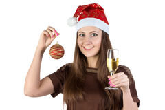 Image of young woman with christmas ball and glass Stock Image