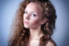 Image of a young woman with curly hair. And green eyes Royalty Free Stock Photos