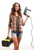Image of young woman with drill and toolbox over white backgro Stock Photo