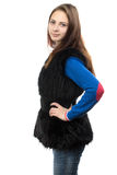 Image of the young woman in fake fur waistcoat Royalty Free Stock Image