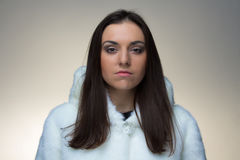 Image of the young woman in fur coat Royalty Free Stock Photos