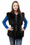 Image of the young woman in fur waistcoat Royalty Free Stock Image