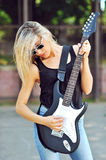 An image of a young woman with guitar Stock Image